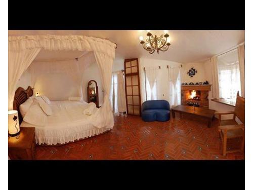 Habitación de novios con cama queen size