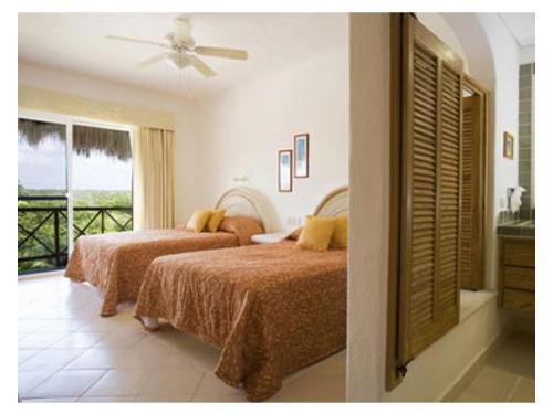 Habitación con dos camas matrimoniales